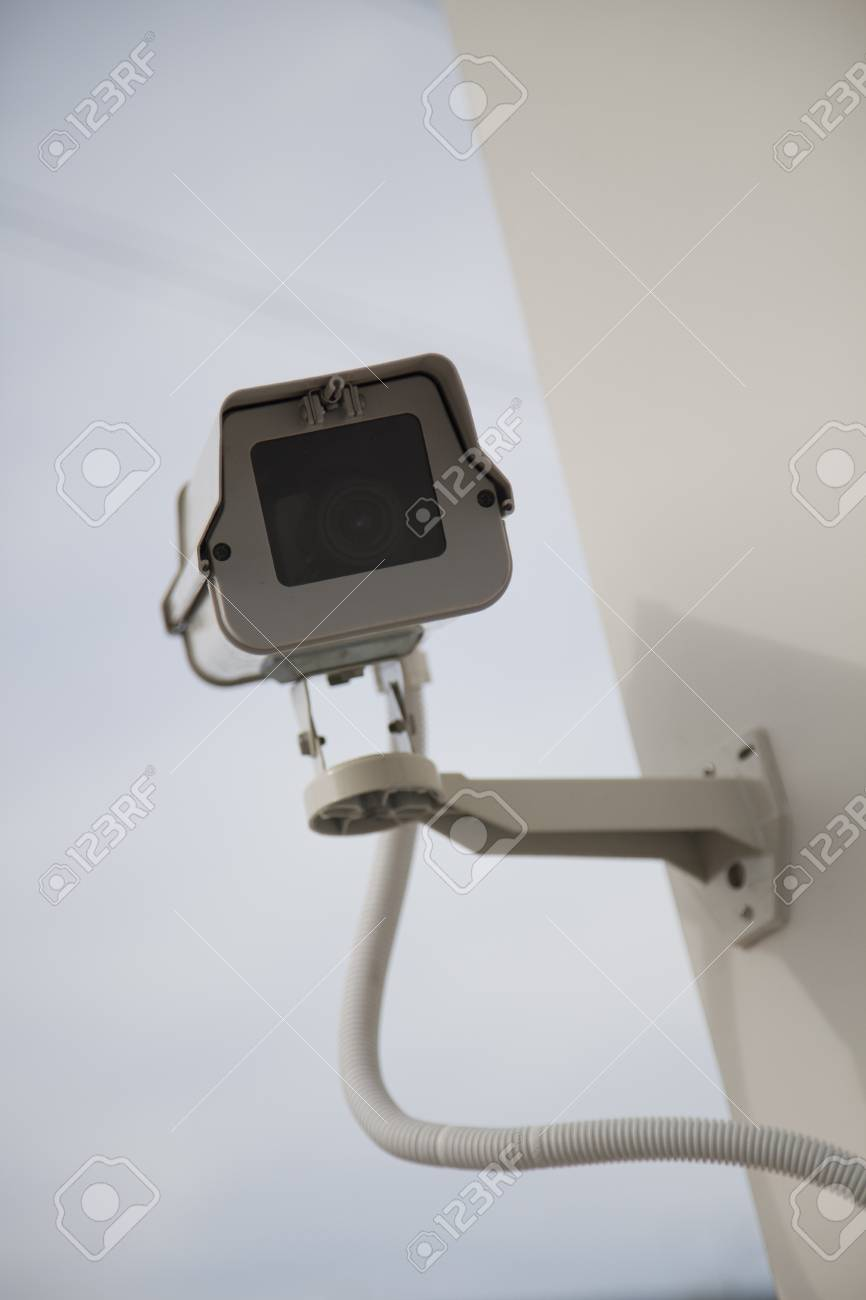 CCTV security camera at home on sky. Stock Photo - 14043062