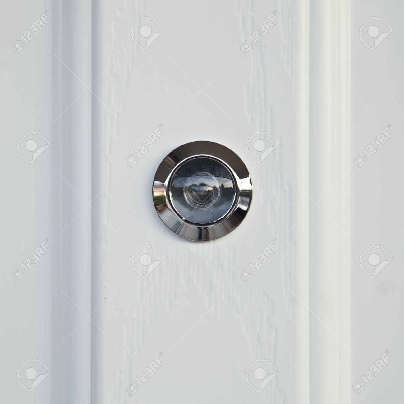 White Wood Door Texture close up, door lens peephole on white wooden texture stock photo