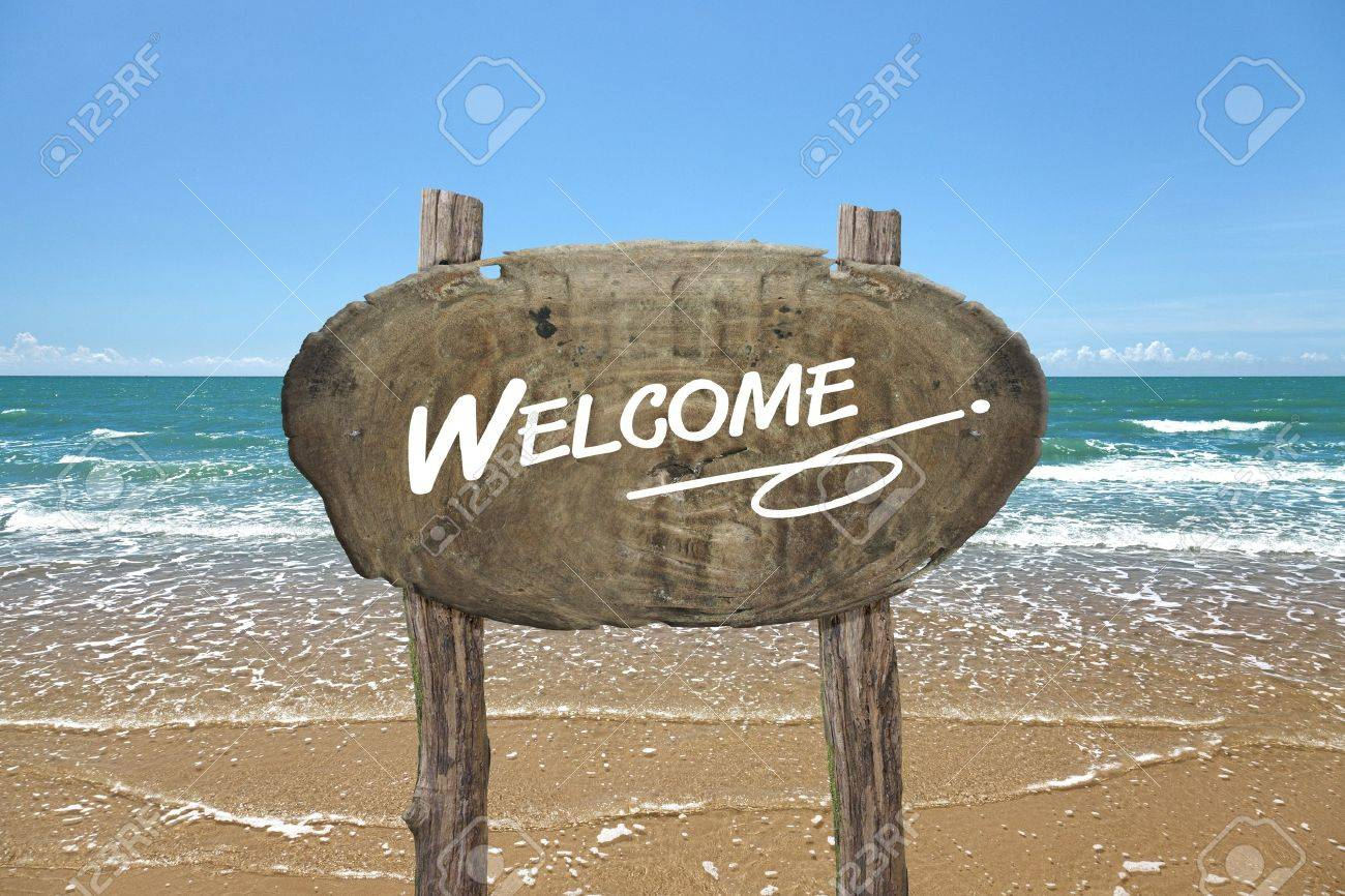WELCOME, wooden signboard on tropical beach Stock Photo - 19370614
