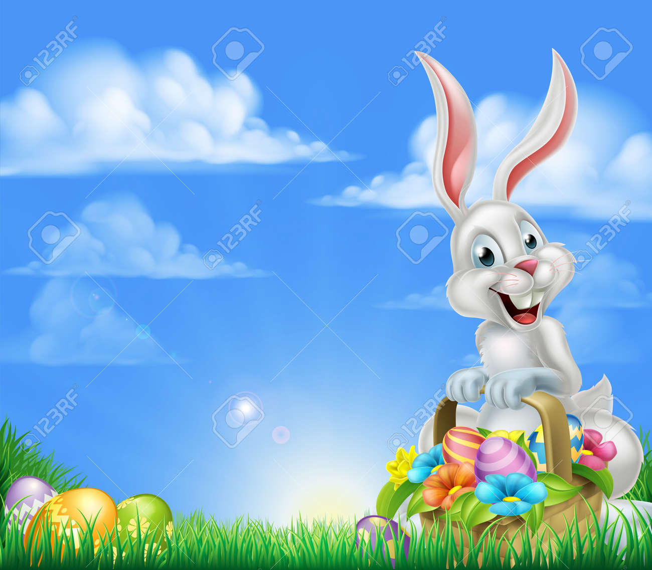 White Easter bunny with a basket full of decorated chocolate Easter eggs in a field Easter background - 52211438