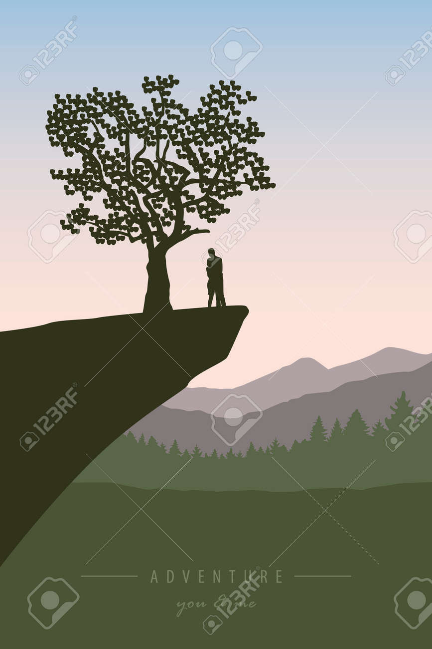 couple in love on a cliff under a tree with mountain view - 169841409