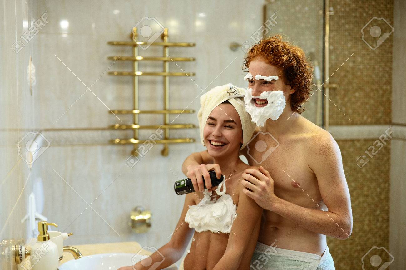 Lovers Having Fun And Playing With Shaving Foam In The Bathroom
