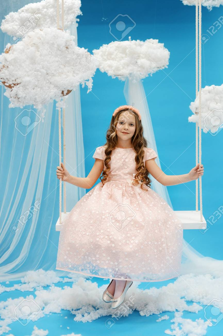 Girl In White Dress Swinging On A Swing In Heaven. Angel Paradise ...