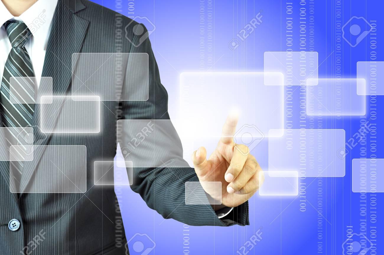Businessman touching virtual screen Stock Photo - 17017113