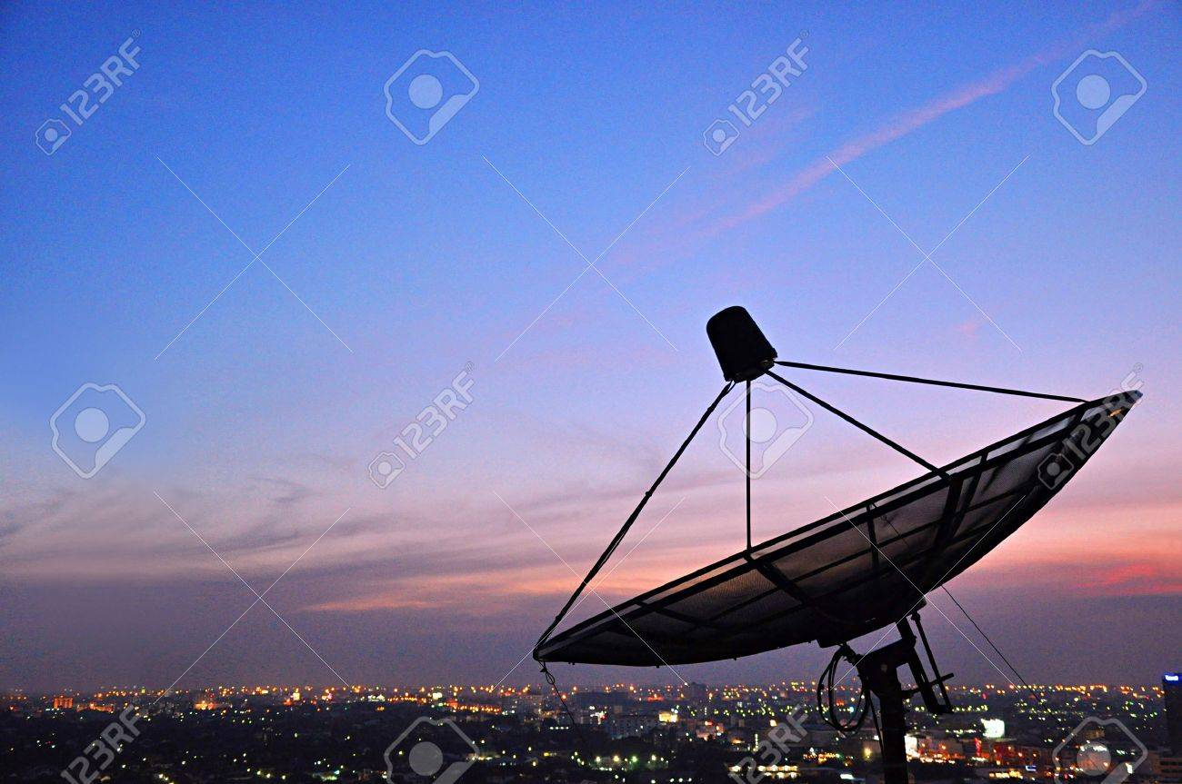 a satellite dish above the city stock photo picture and royalty