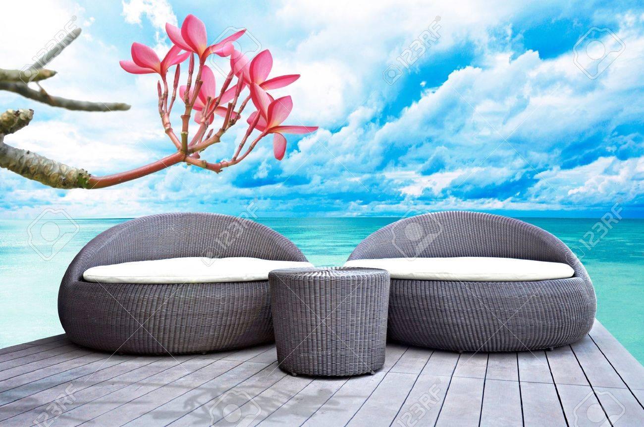 Rattan seat lounge beside the sea Stock Photo - 18820060
