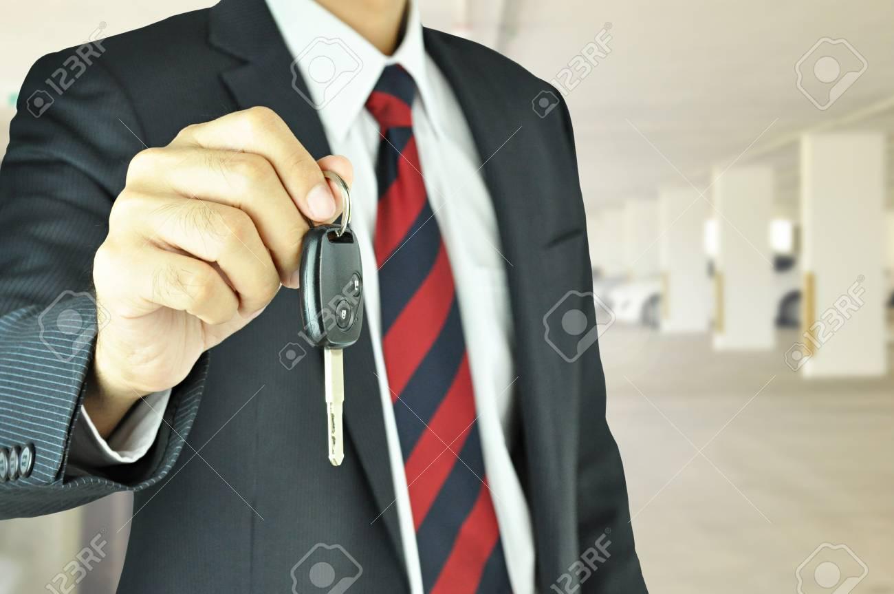 Businessman giving a car key Stock Photo - 21014080