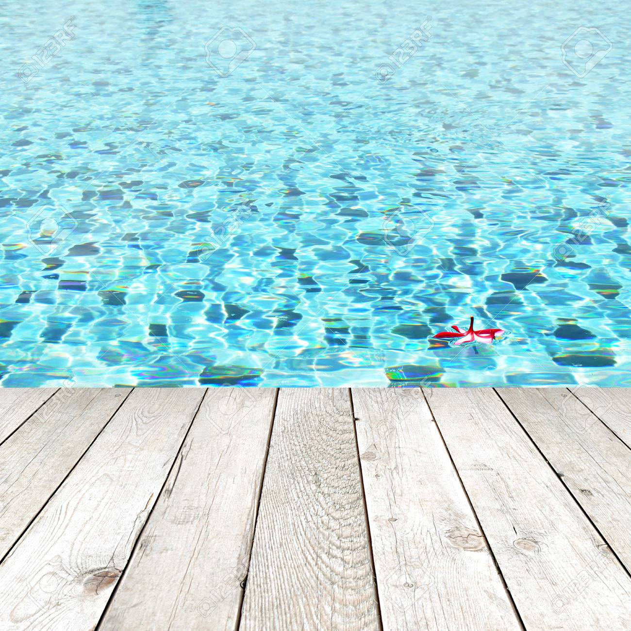 Swimming Pool Background wood plank on swimming pool water background - spa concept stock