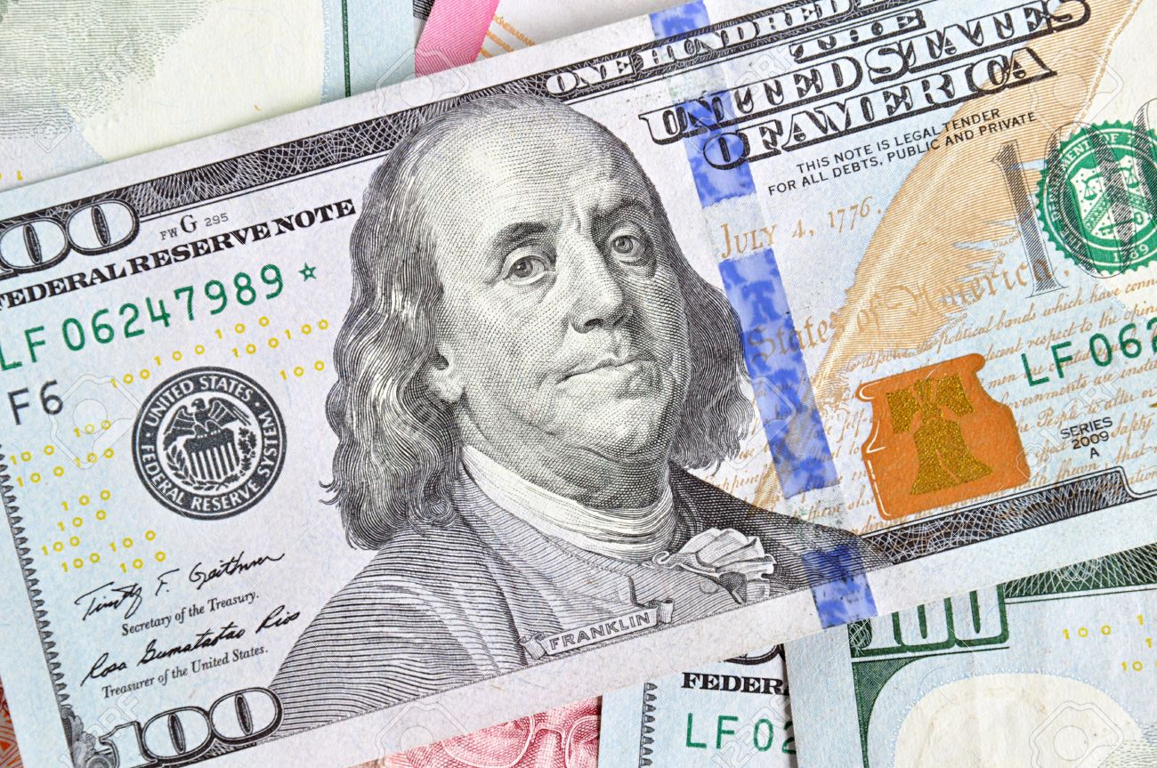Money - 100 United States dollars (USD) bills - focusing on Benjamin