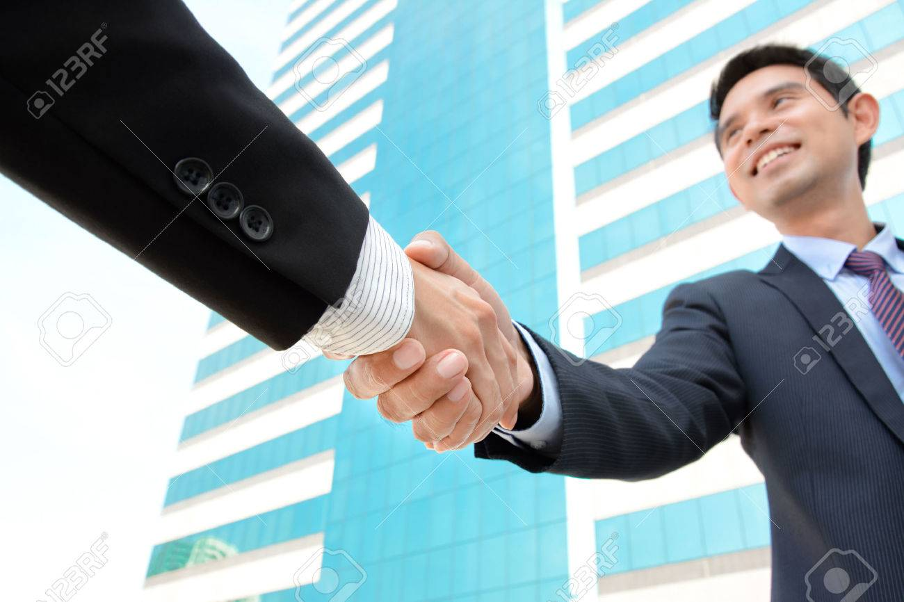 Business people handshake greeting deal at work photo free download - Handshake Of Businessmen With Smiling Face Greeting Dealing Merger Acquisition Concepts Stock