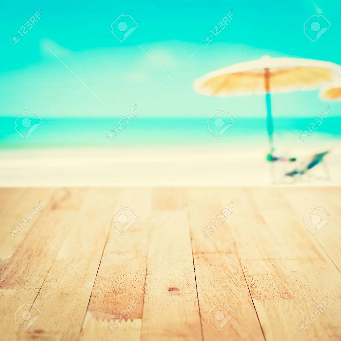Wood Table Top On Blurred White Sand Beach Background, Vintage Tone   Can  Be Used