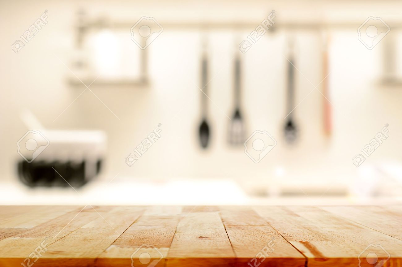 Wood Table Top as Kitchen Island On Blur Kitchen Background ...