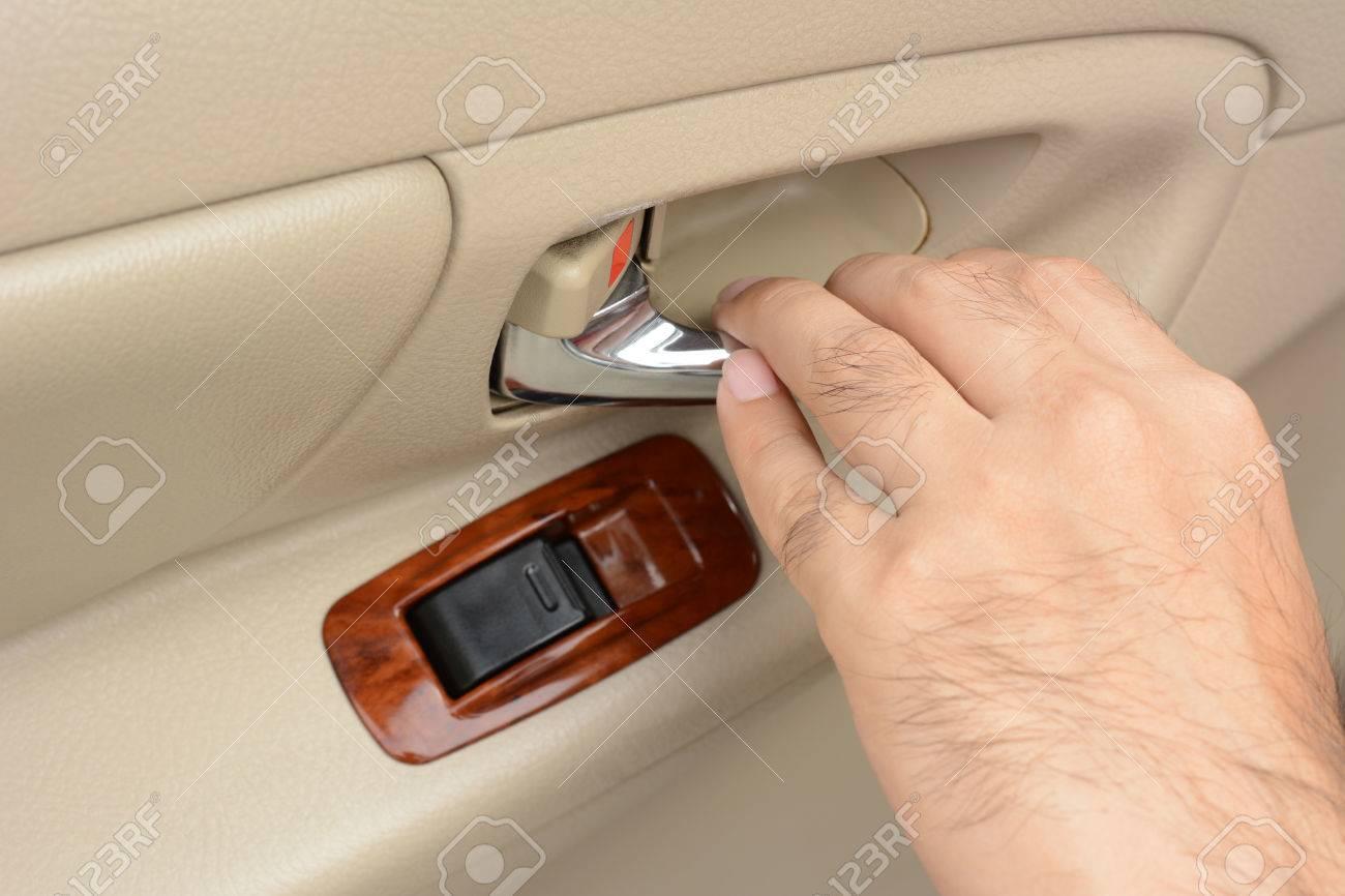 Car door handle hand Interior Door Hand Pulling Car Interior Door Handle Opening Car Door Stock Photo 43017017 123rfcom Hand Pulling Car Interior Door Handle Opening Car Door Stock Photo