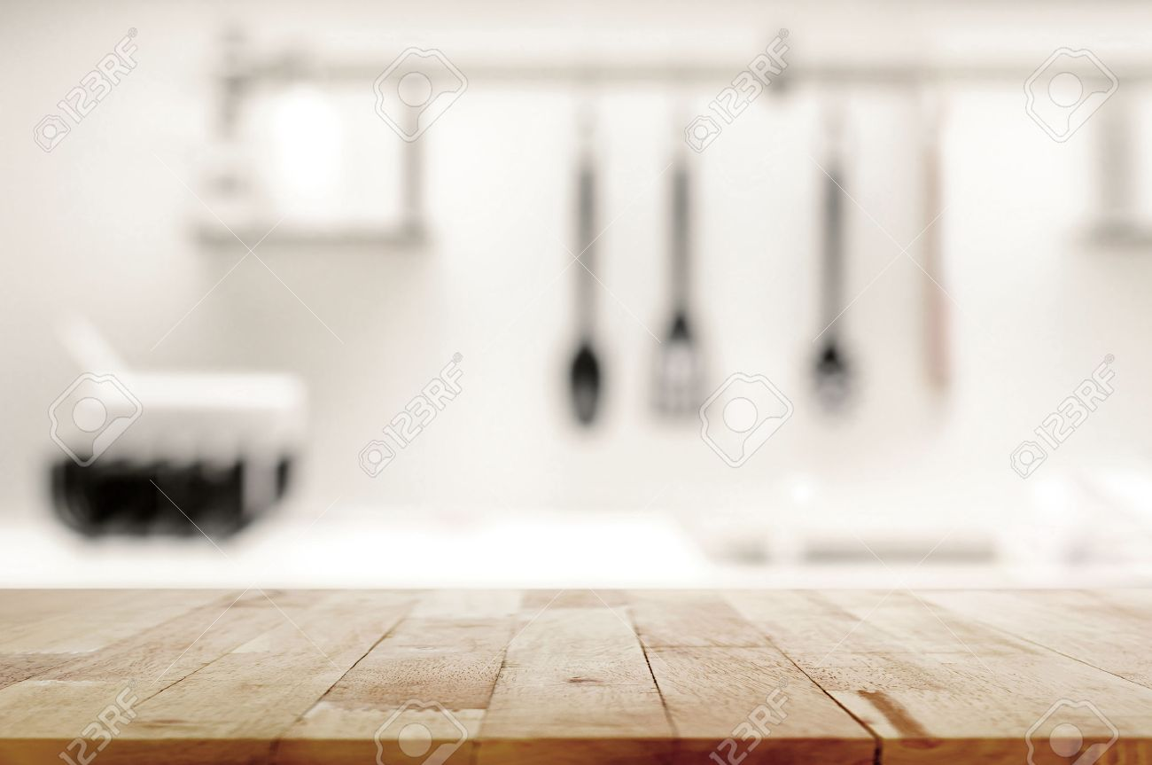 Kitchen Table Top Background wood table top on blur kitchen background - can be used for