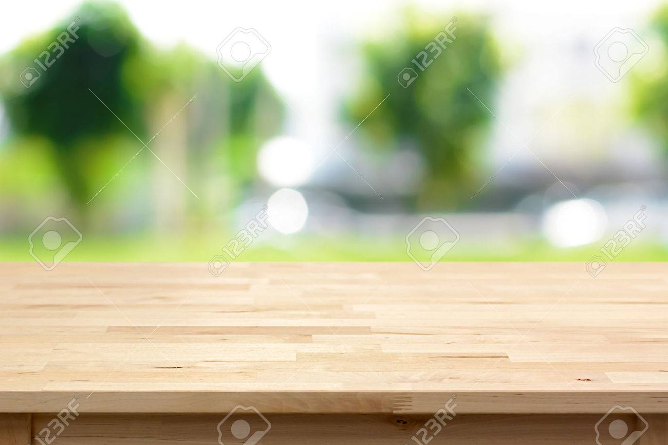 Wood Table Top On Blurred Green Tree Background   Can Be Used For Montage  Or Display
