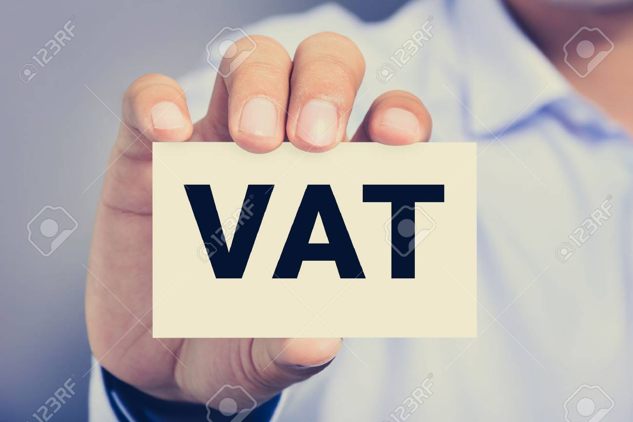 Vat Letters Or Value Added Tax On Business Card Shown By A