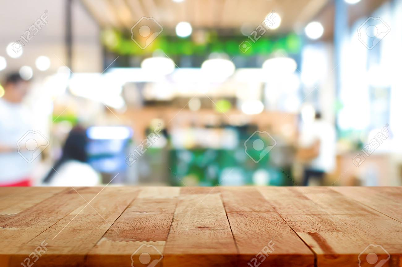 Wood Table Top On Blur Cafe Restaurant Interior Background Stock Photo Picture And Royalty Free Image Image 56595123
