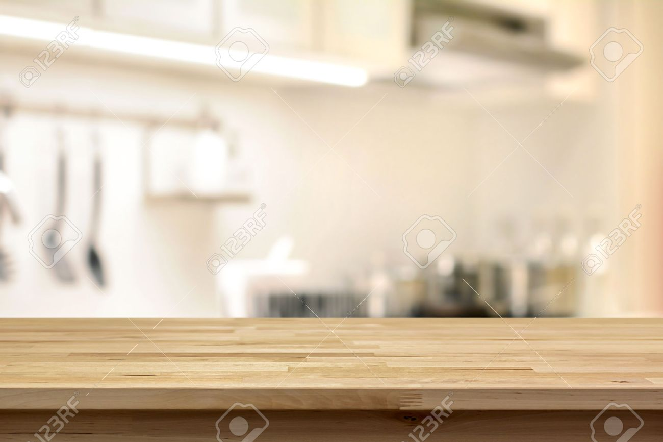 wood table top as kitchen island on blur kitchen background