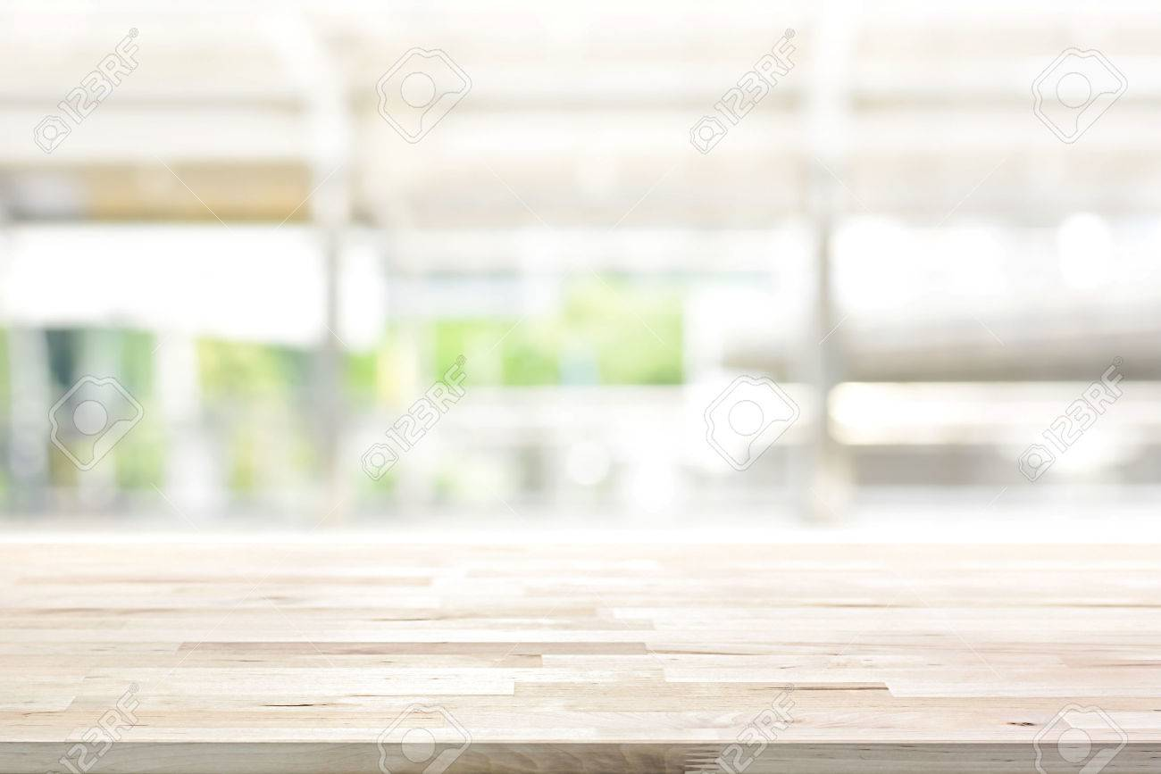 Wood table top on blur kitchen window background   can be used..