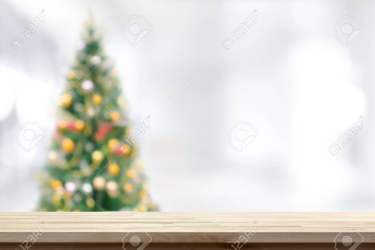 Wood Table Top On Blur Christmas Tree Background Can Be Used