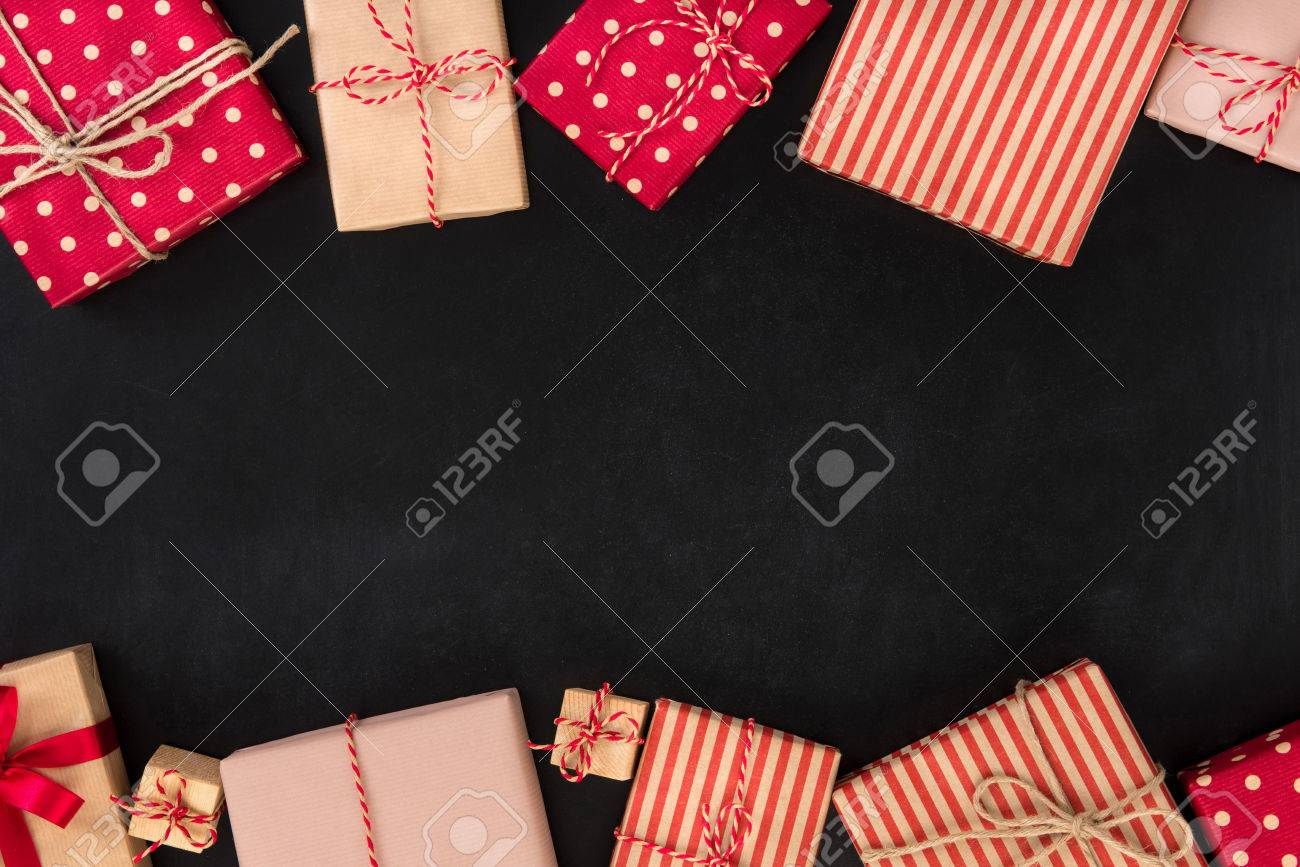 gift boxes border design on blackboard christmas and new year theme background stock photo