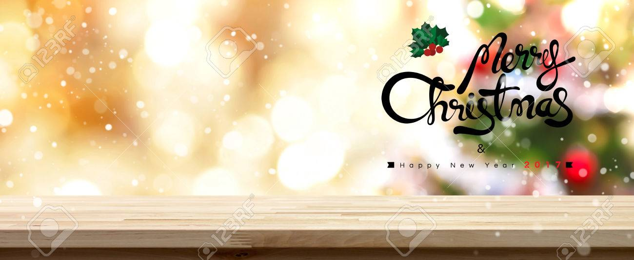 merry christmas and happy new year 2017 table top panoramic banner background golden theme stock
