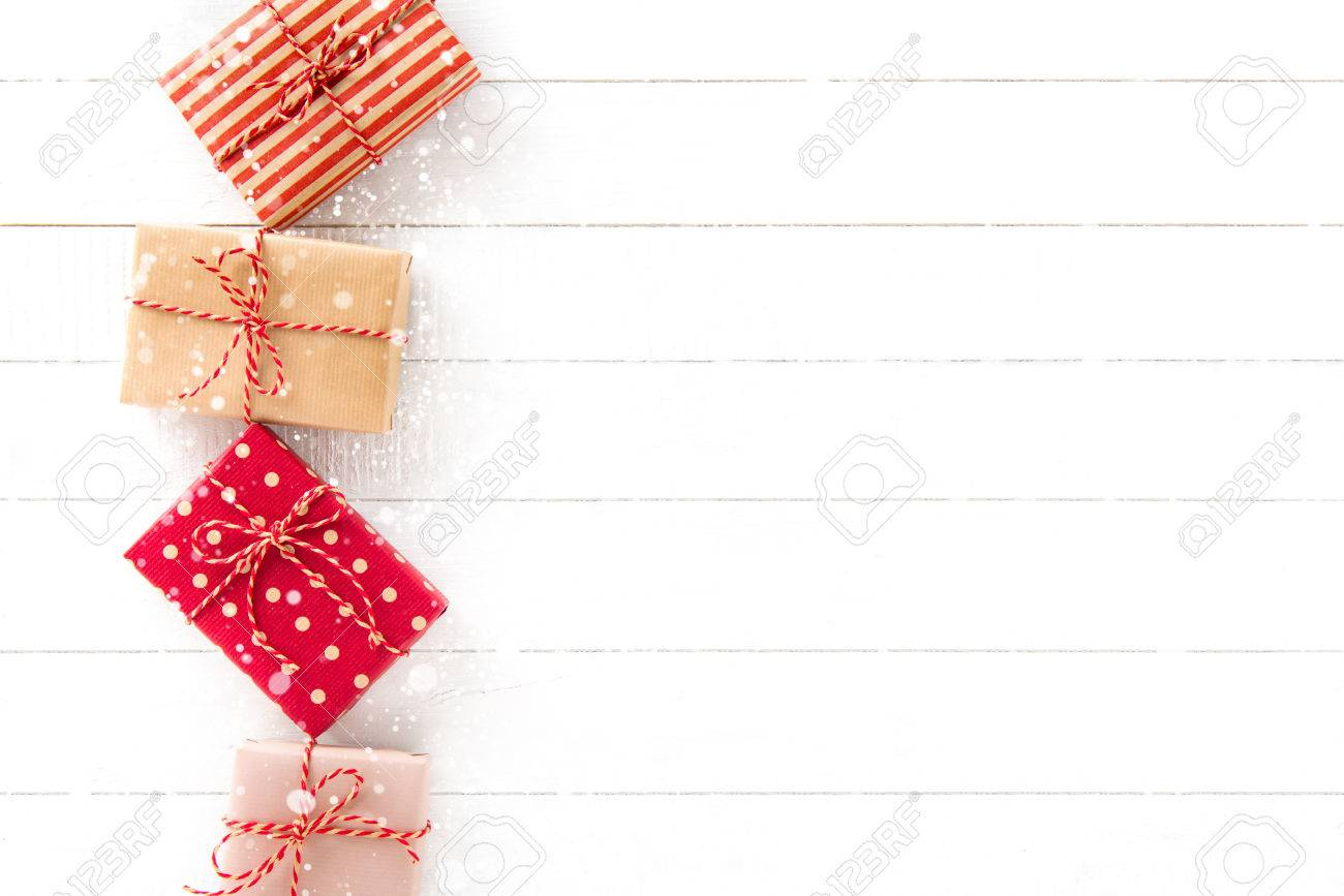 gift boxes border design on white wood background christmas and new year theme