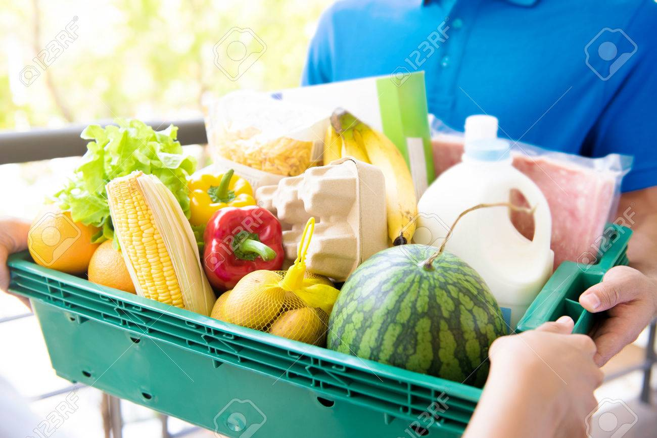 Delivery man delivering food to customer - online grocery shopping