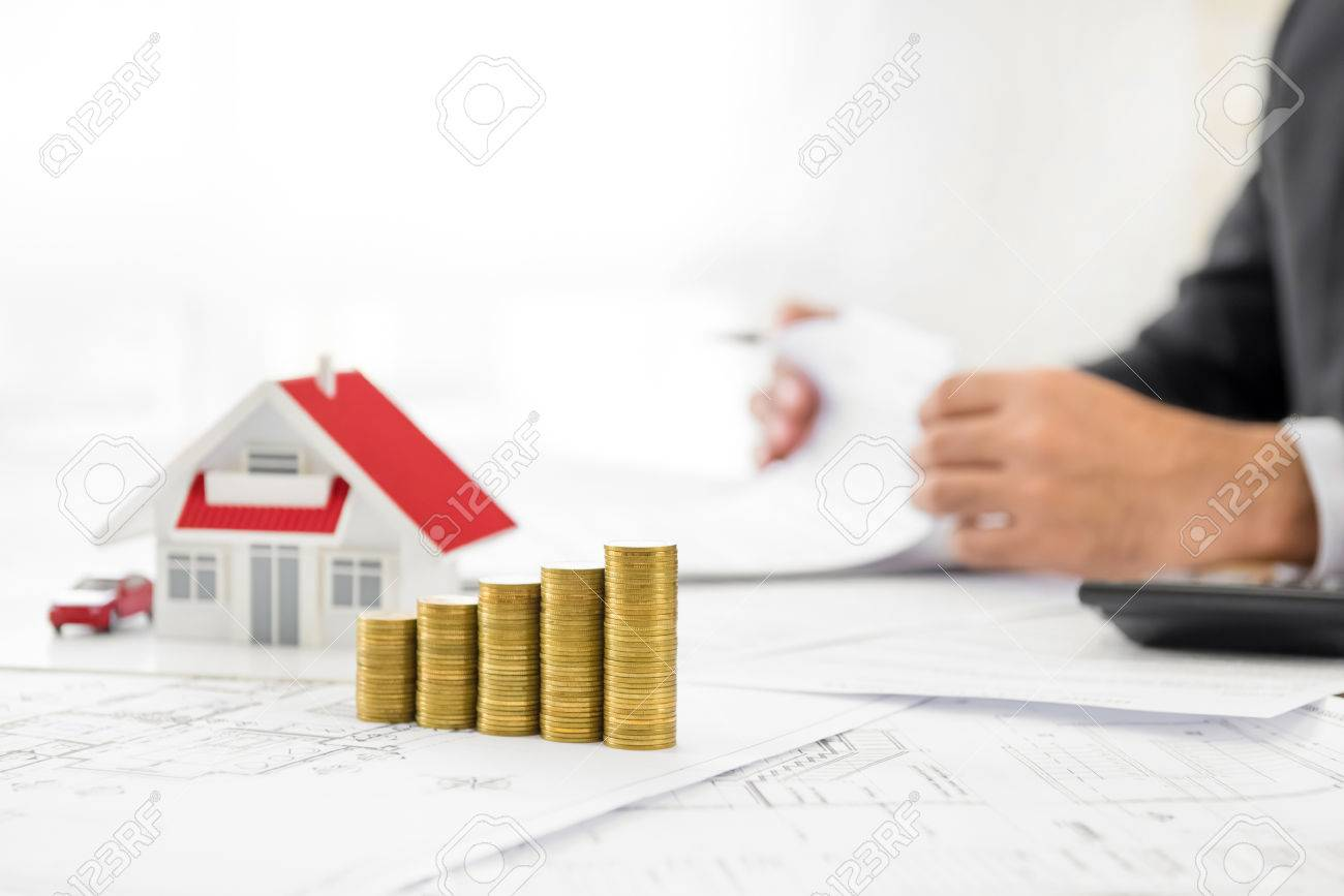 Money and house model on blueprint paper at the table with blurred money and house model on blueprint paper at the table with blurred businessman in background malvernweather Images
