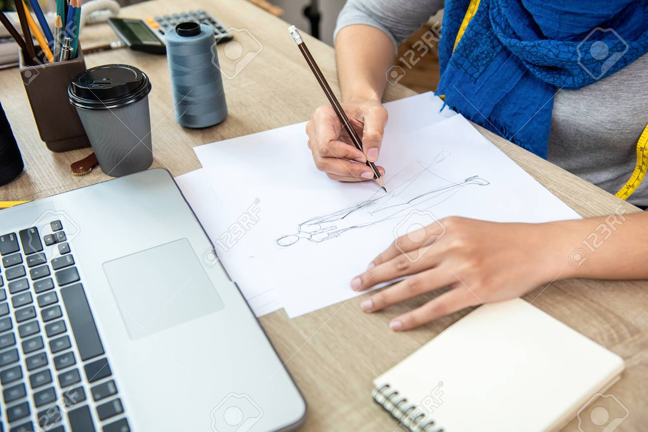 Muslim Woman Fashion Designer Drawing A Dress Design Sketch In Stock Photo Picture And Royalty Free Image Image 114004641