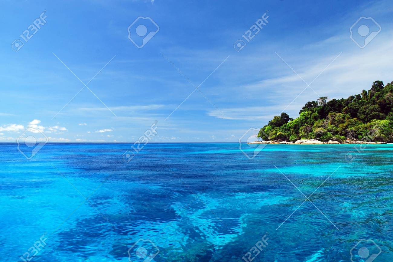 Blue Sea with coral reef and fluffy clouds from tachai island in Thailand - 19698777