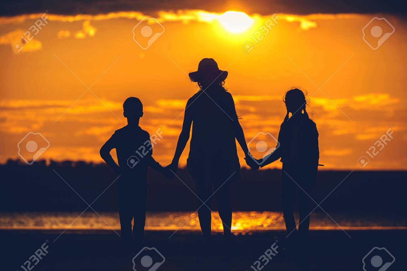 some family silhouette at sunset - 145632539