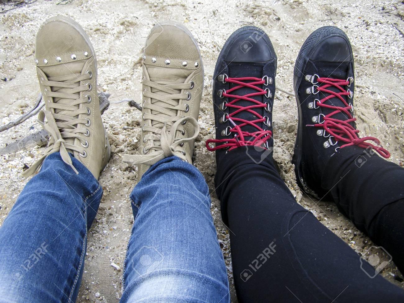 Female Legs Girlfriends On The Beach In