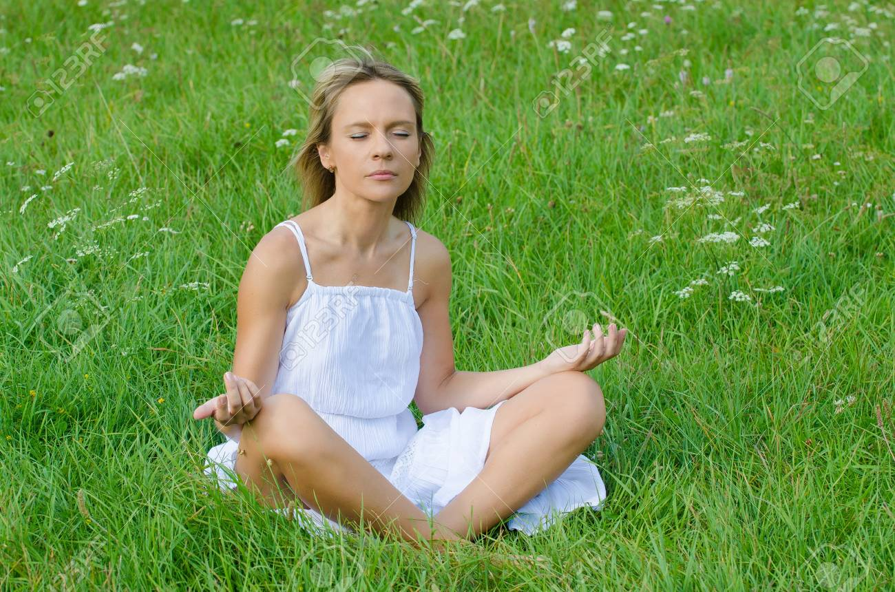 young woman practicing yoga in nature Stock Photo - 22068599