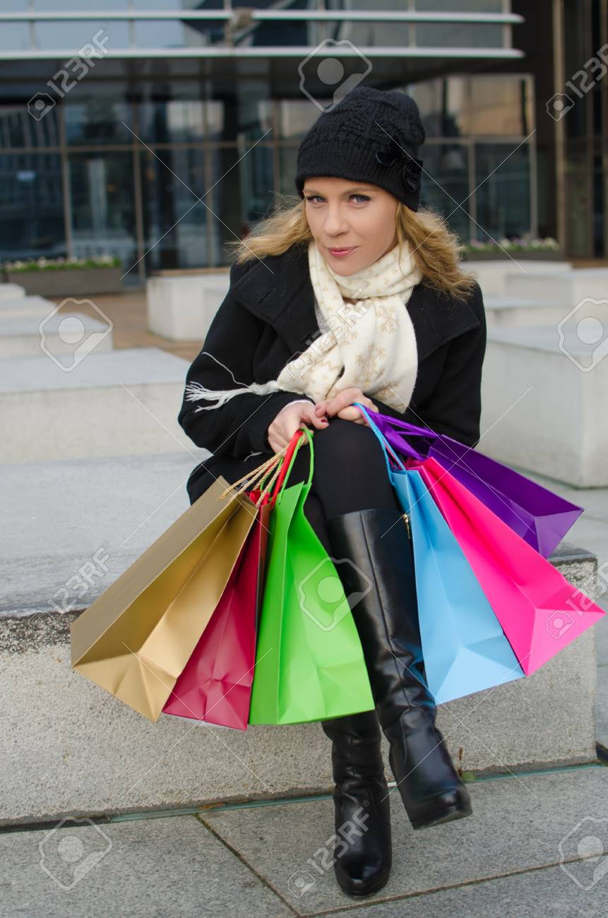 Young woman in black with shopping bags Stock Photo - 23722337