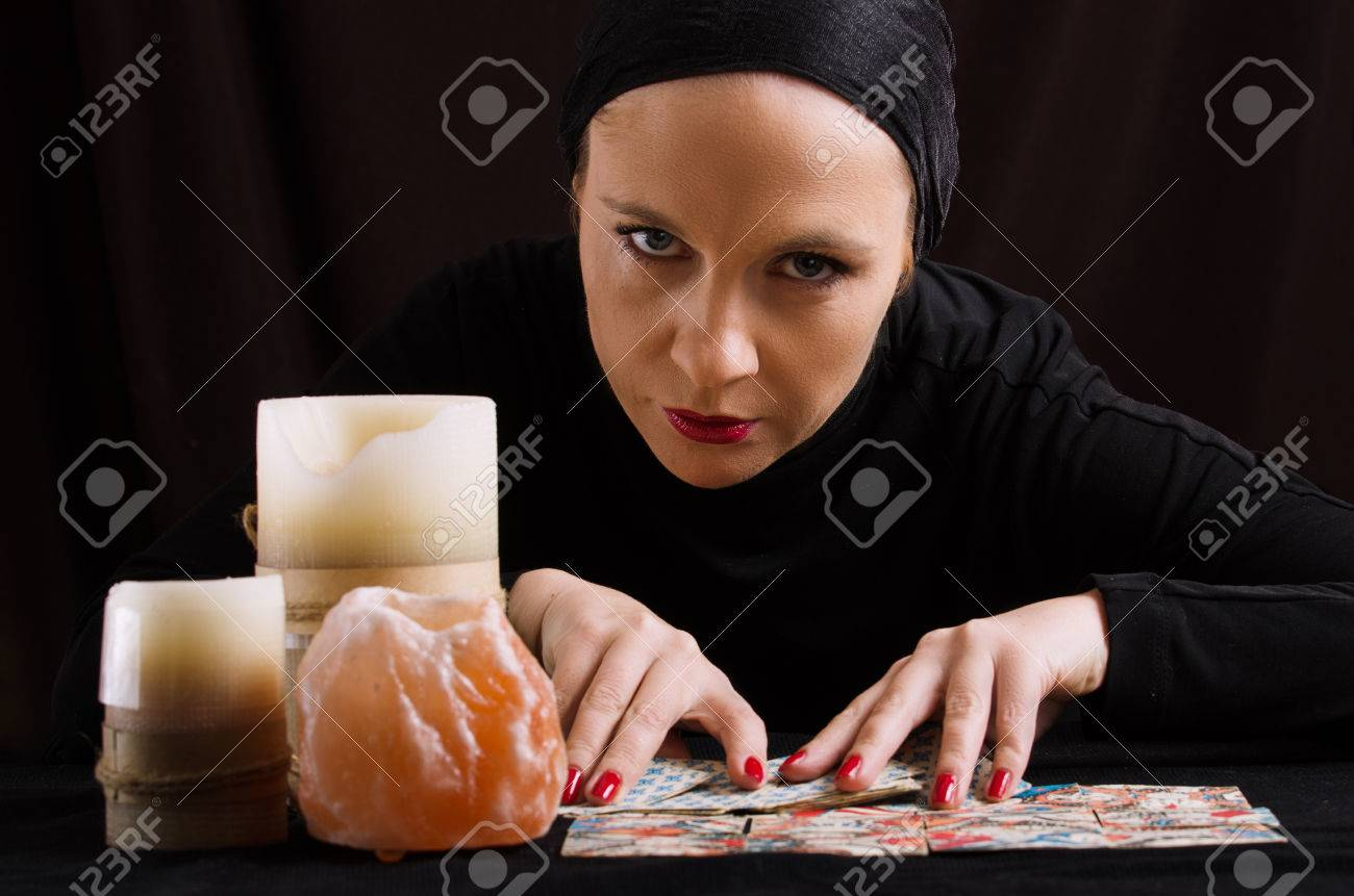young woman with divination cards - 25023976