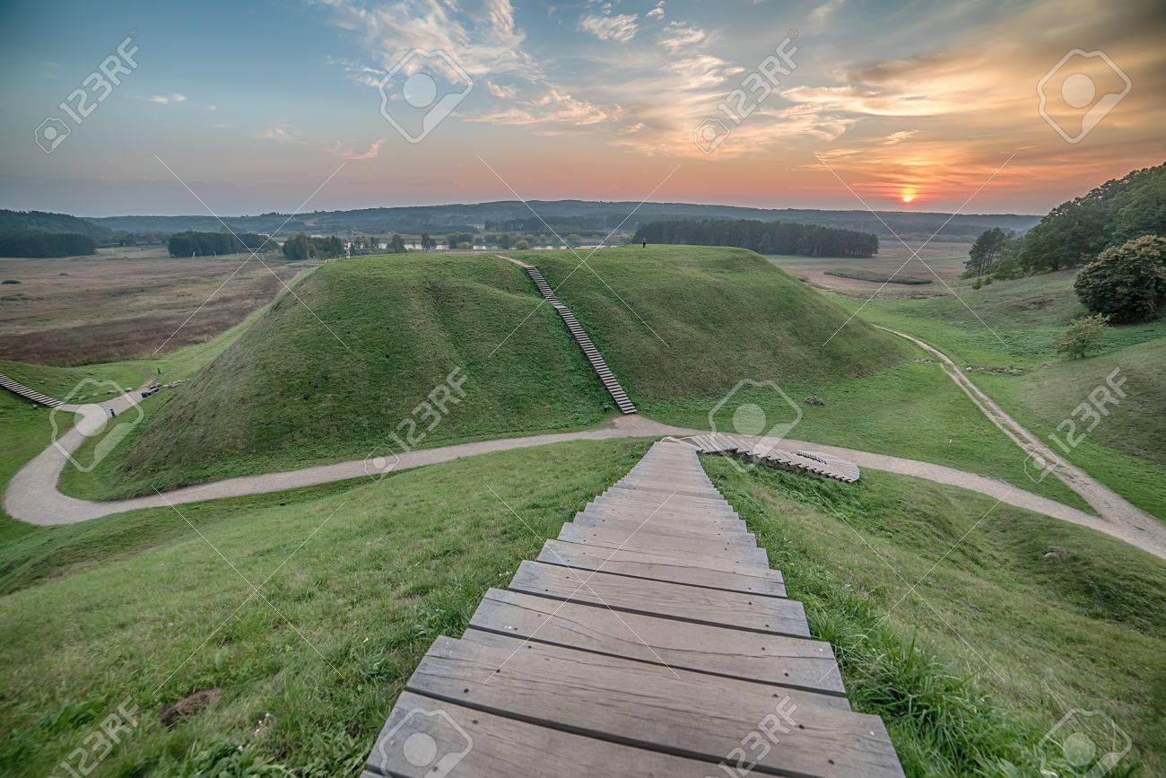 Kernave, historical capital city of Lithuania, in the sunset - 47493874