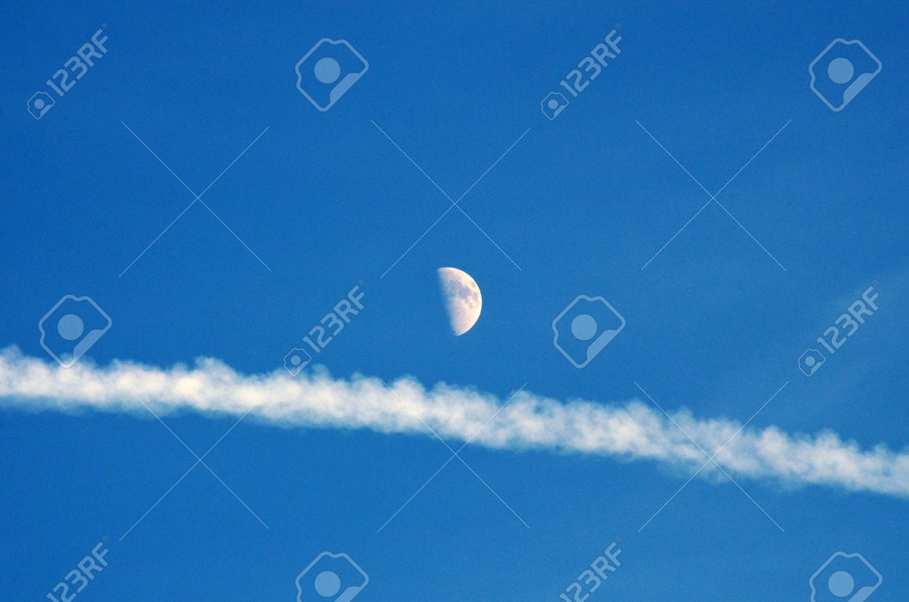 Blue Sky, Vapor Trail And Half Moon Stock Photo, Picture And ...