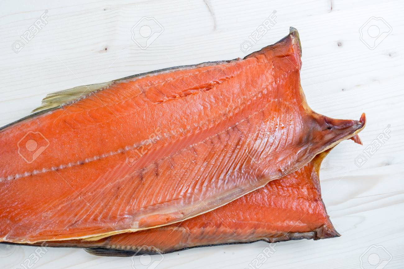 carcass of Cold smoked pink salmon on a wooden background. - 123348640