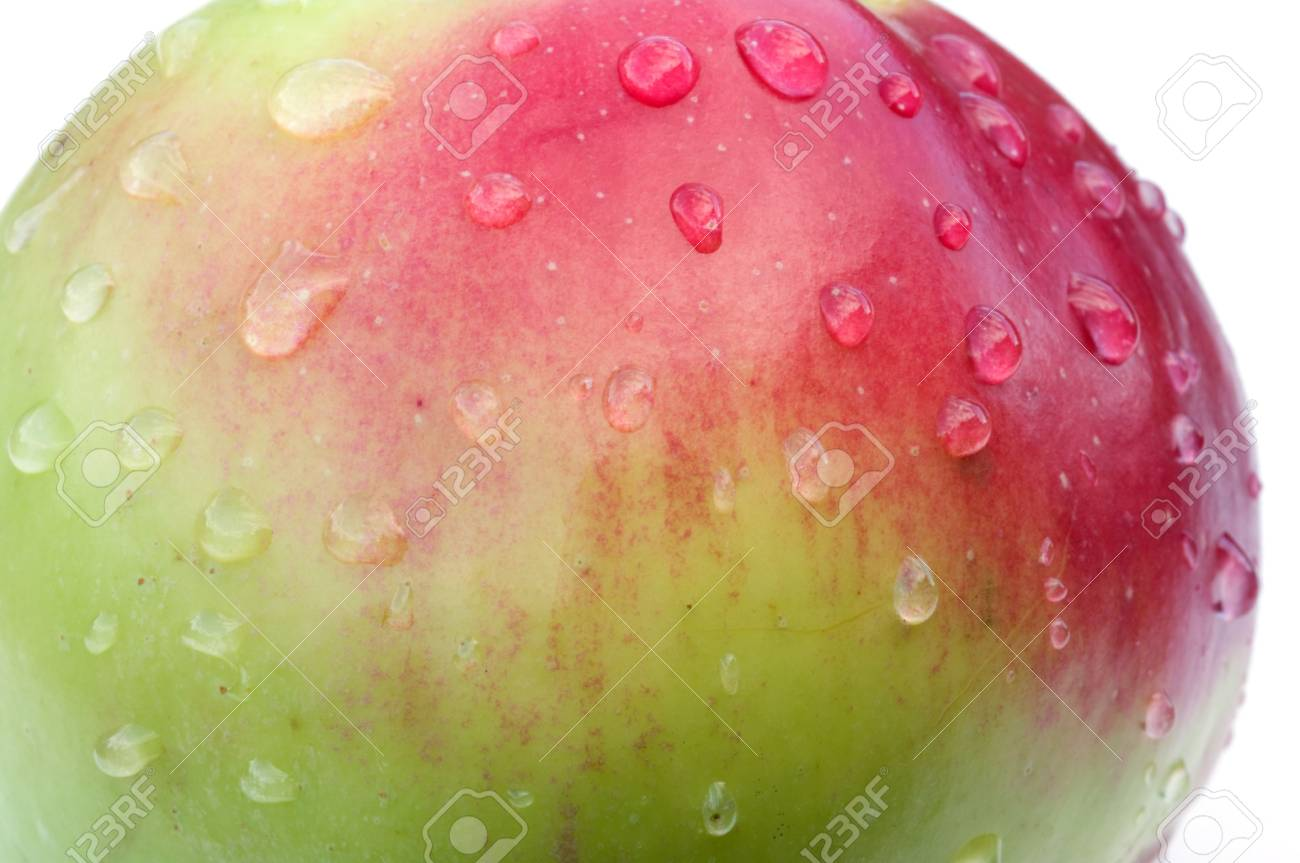 Red ripe apple with liquid drops close up. Stock Photo - 5639541