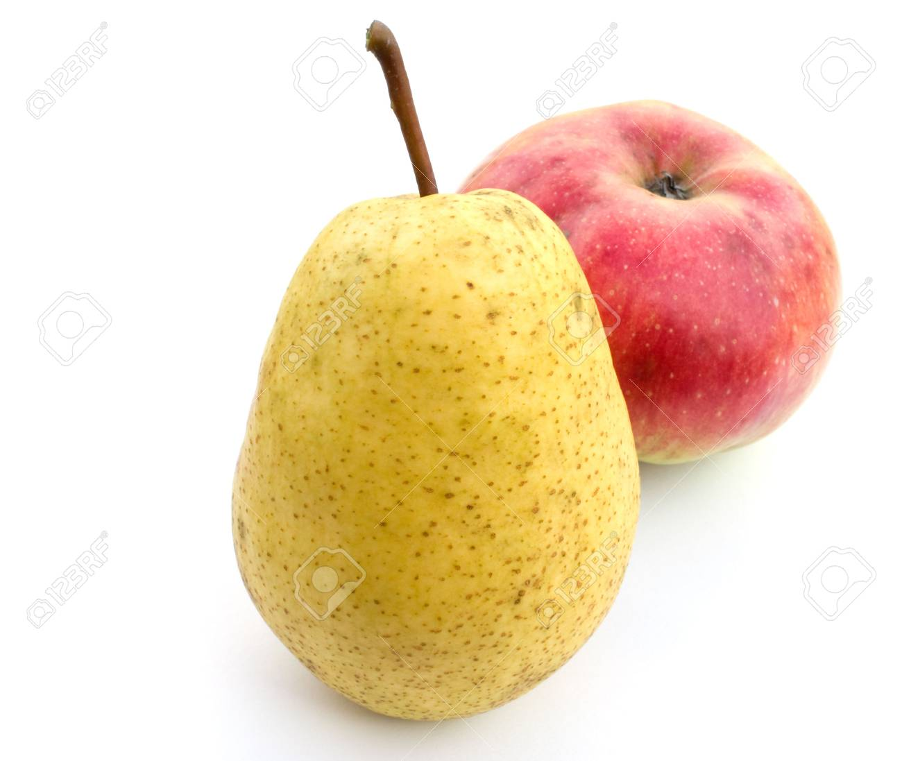 Yellow pear and red apple on a white background. Stock Photo - 5639589
