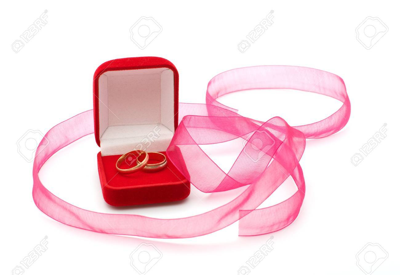 Wedding Rings In The Red Box And A Pink Ribbon On A White Background ...
