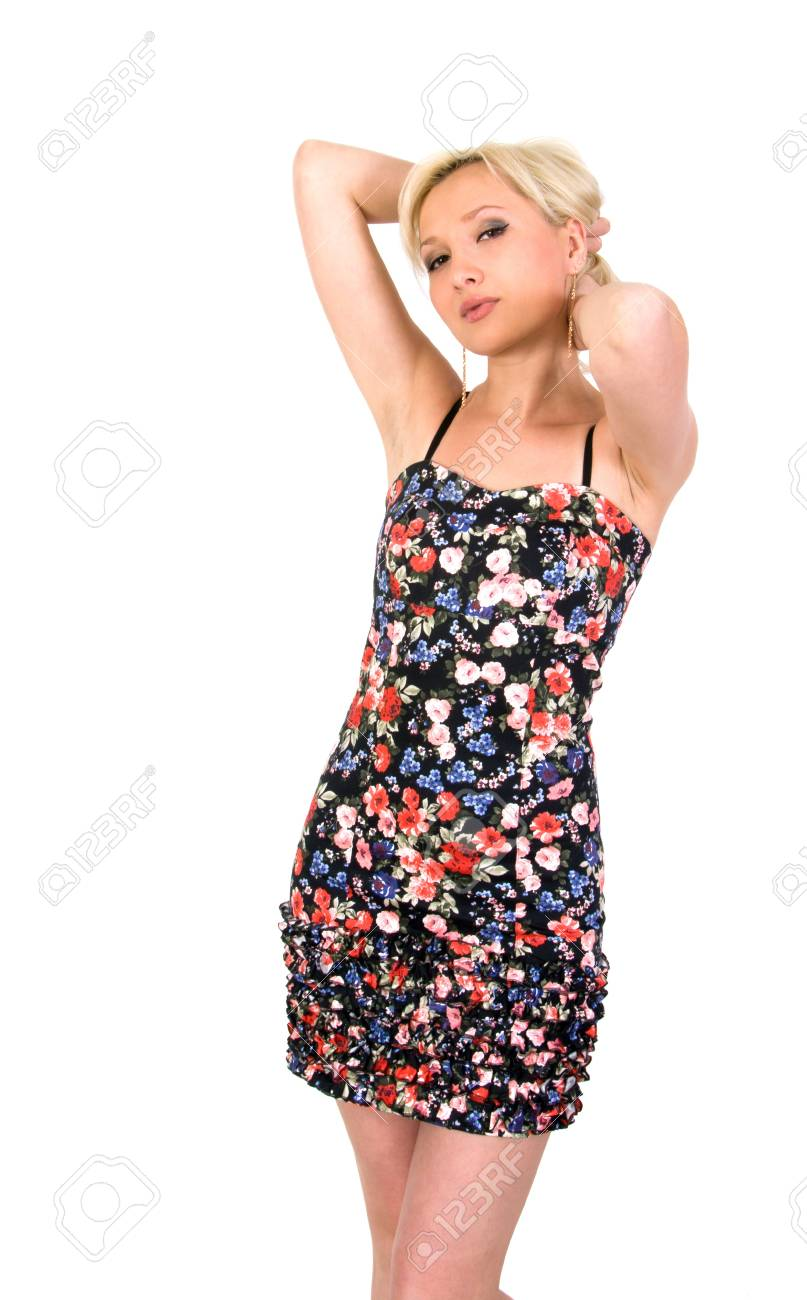 Girl in a flowery summer dress on a white background. Stock Photo - 8649617