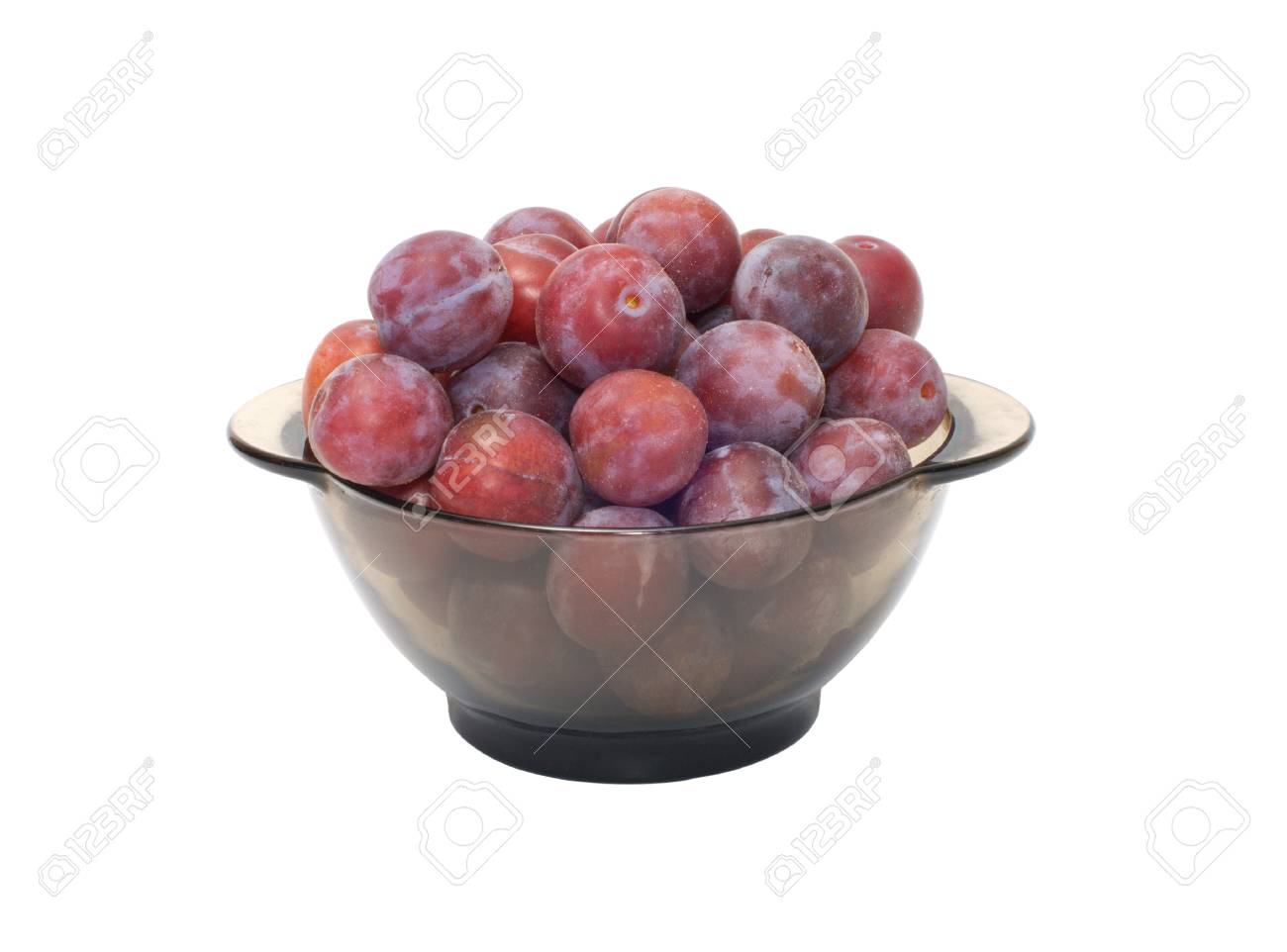 Ripe plums on a plate isolated on a white background. Stock Photo - 10443601