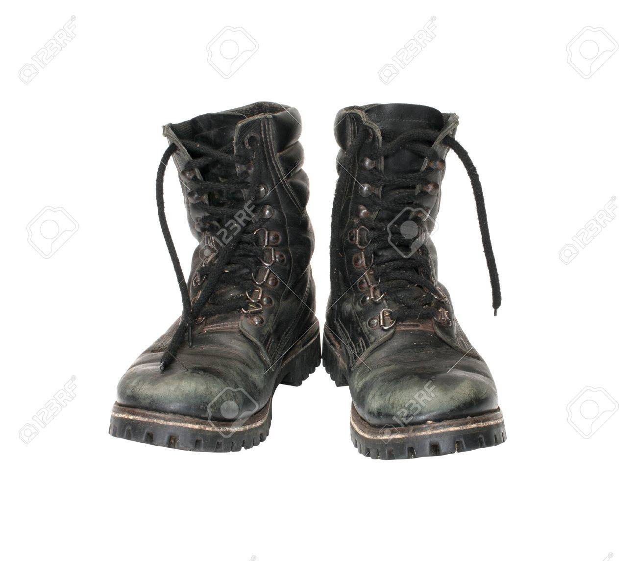 Pair worn army boots it is isolated on a white background. Stock Photo - 12439545