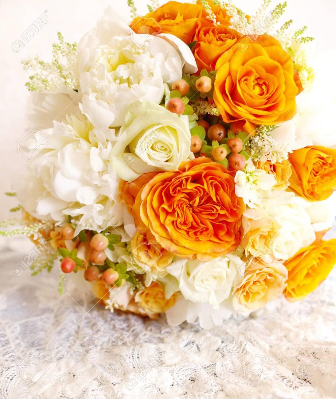 Vintage orange ivory white wedding bouquet on lace background stock stock photo vintage orange ivory white wedding bouquet on lace background mightylinksfo