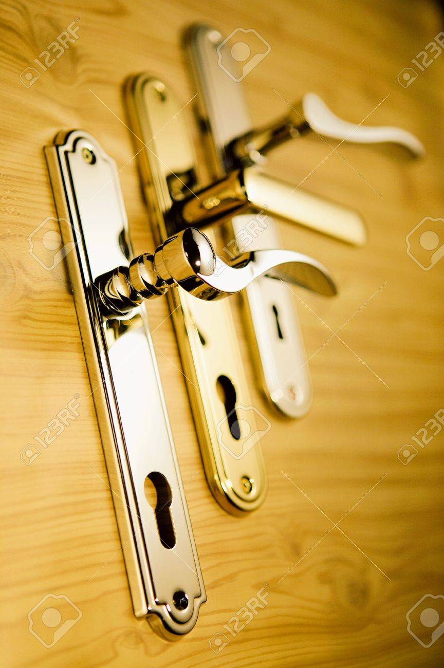 A series of golden handls on a wooden board 2 Stock Photo - 6280579