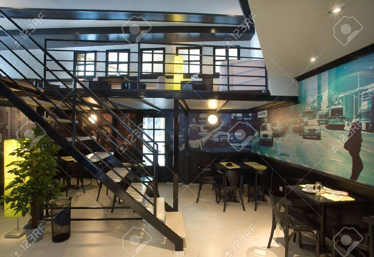 Interior Of Cafe Bar Designed With Street Wallpapers And Vintage