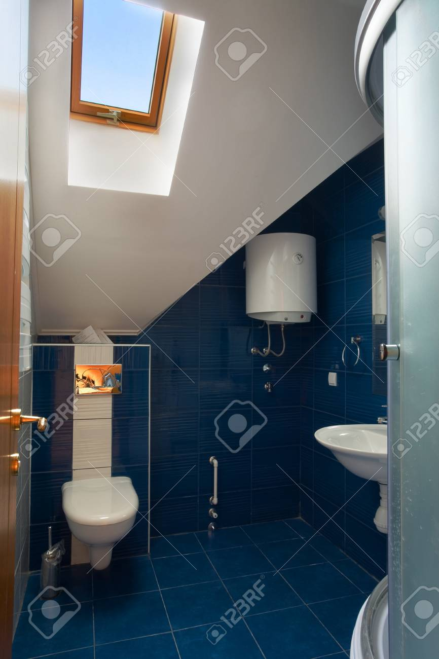 New small apartment bathroom in blue. Stock Photo - 8551775