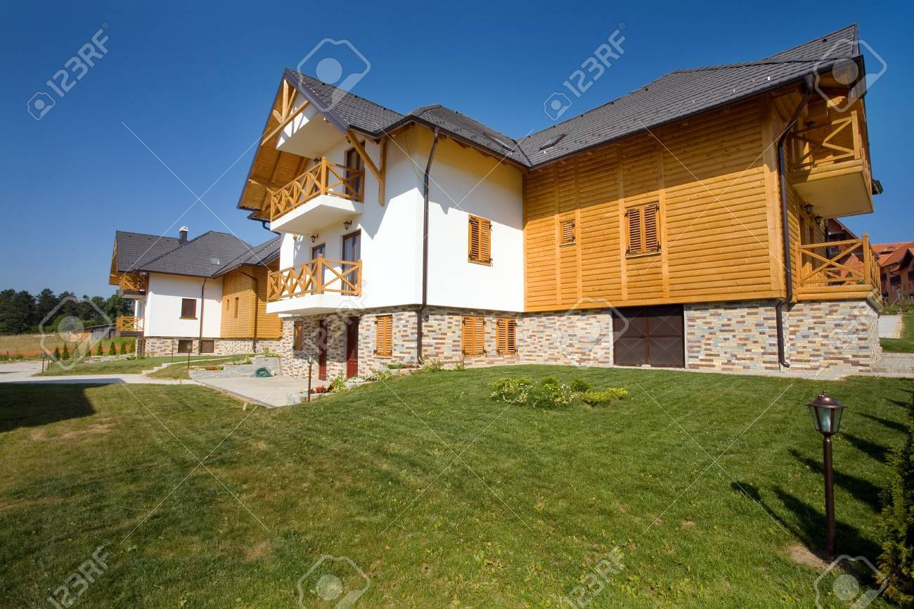 New empty house perspective. Modern and traditional styles mixed. Apartments on sale. Stock Photo - 8658572